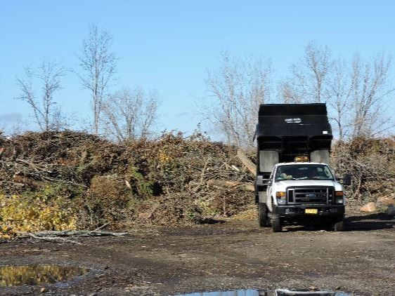 with BPU Yard Waste Site with truck dumping yard waste